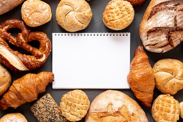 Bread croissants and a notebook