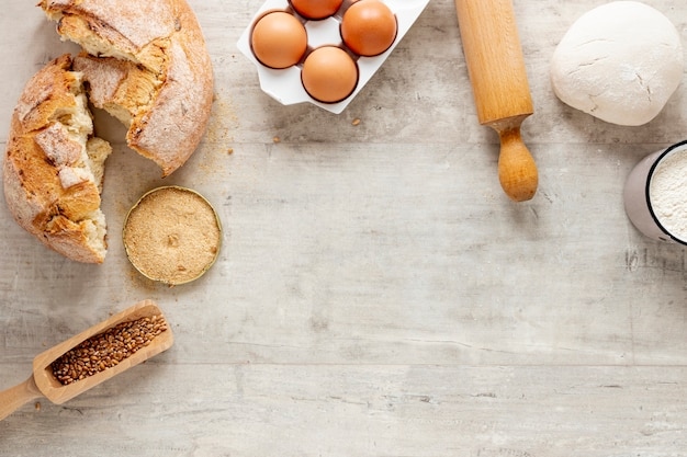 Bread and dough ingredients with copy space