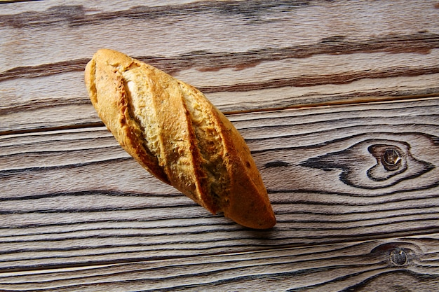 Bread fresh loaf on rustic wooden background