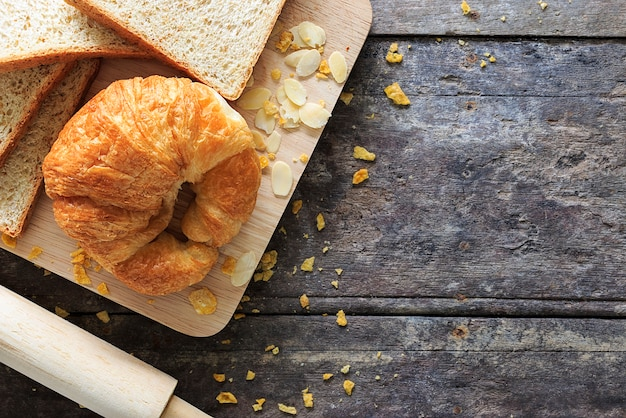 Bread grains and ingredients on wood background