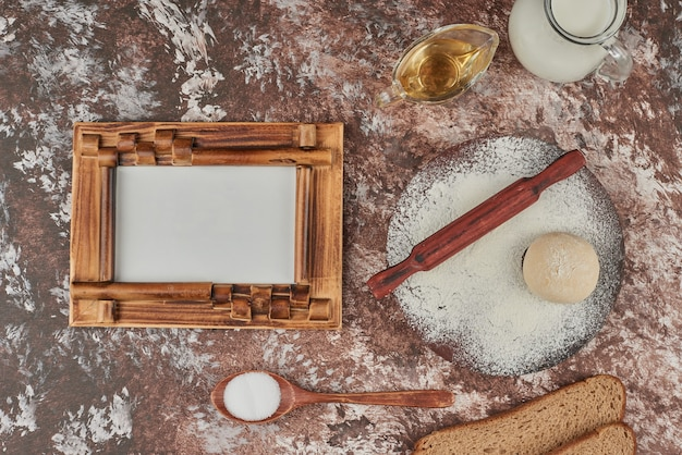 Bread ingredients around a frame for pricing.