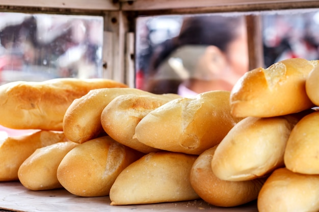 Bread is sold in a morning market in laos