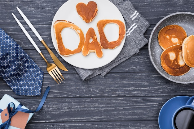 Bread letters for father's day on wooden background