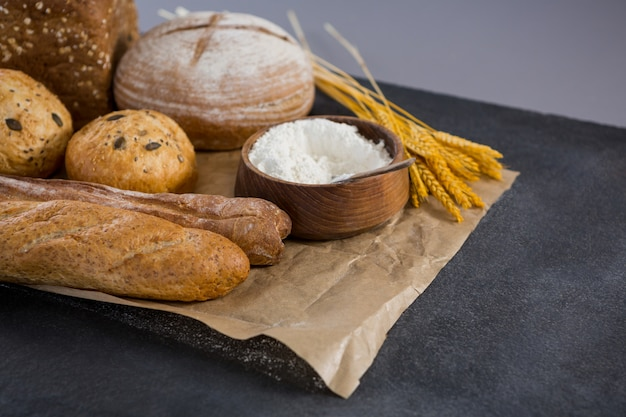 Bread loaves with wheat grains and flour