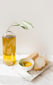 Bread and olive oil with salt on tray