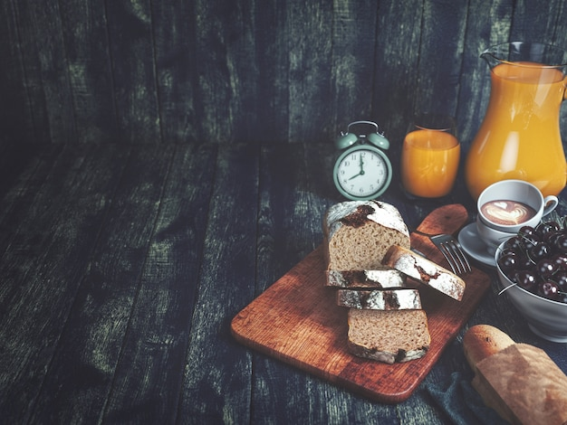 Bread, orange juice, cherries and clock.