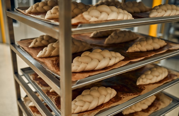 Bread on the shelves is being prepared for baking in the oven. production of bakery products.