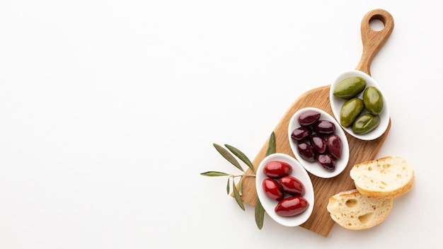 Bread slices and purple red green olives with copy space