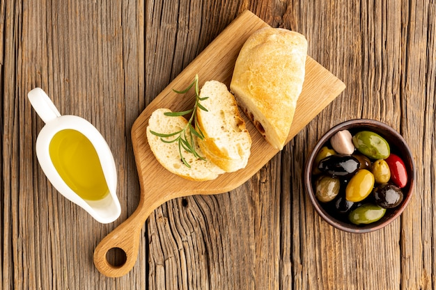 Bread slices with oil sauces and olives mix