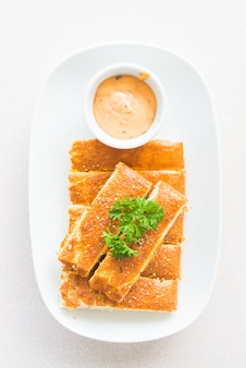 Bread stick with sauce
