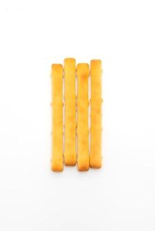 Хлебные палочки на белой поверхности