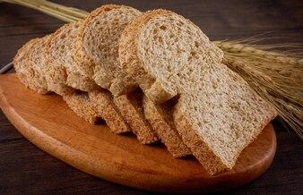 Bread toast on wooden plate