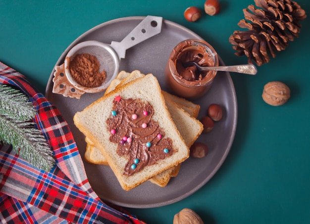 Bread toast with chocolate cream butter with christmas tree