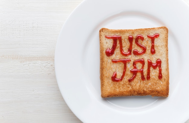 Bread toast with jam in the form of inscriptions just jam it