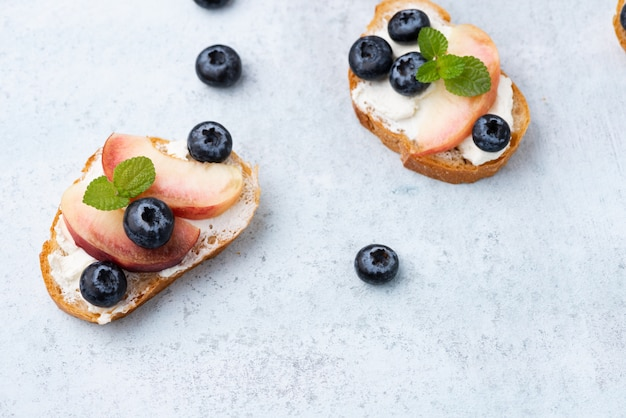 Bread toast with peach and blue berry