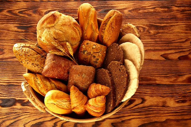 Bread varied mix on golden aged wood table