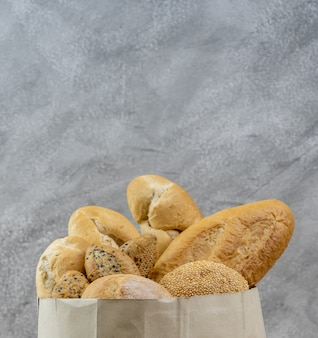 Bread variety in disposalable paper bag.