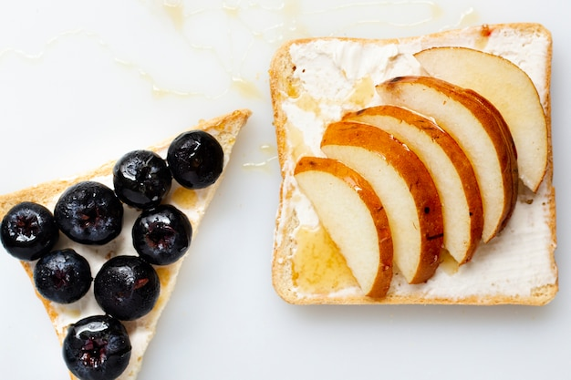 Bread with butter honey and fruits