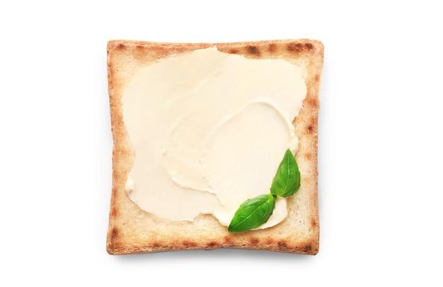 白に分離されたバターとパン