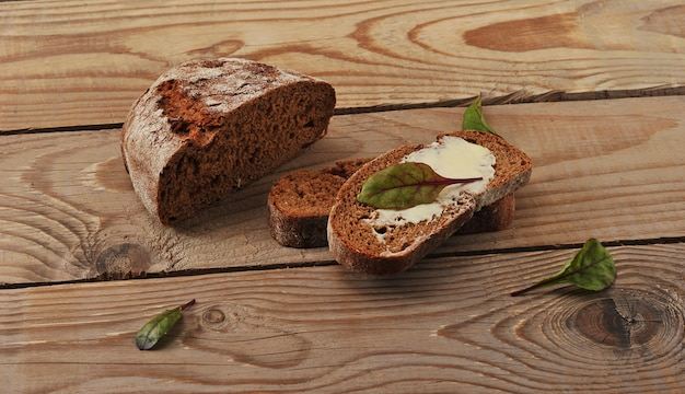 Bread with butter on a wooden rustic surface