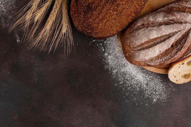 Bread with flour on textured background