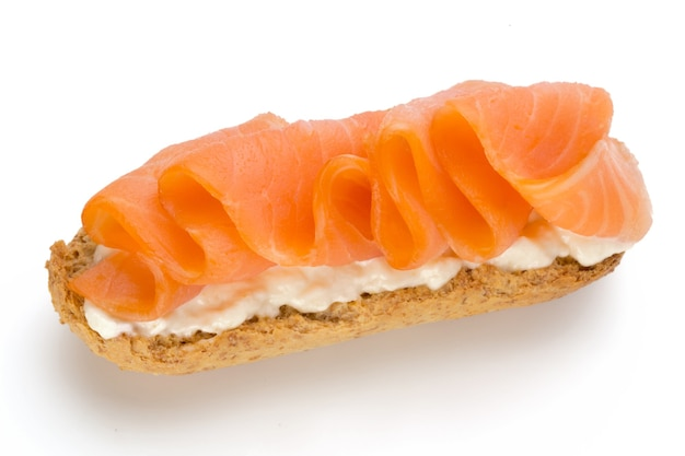 Bread with fresh salmon fillet isolated on white background, top view.
