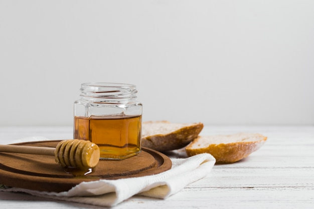 Bread with honey on wooden board