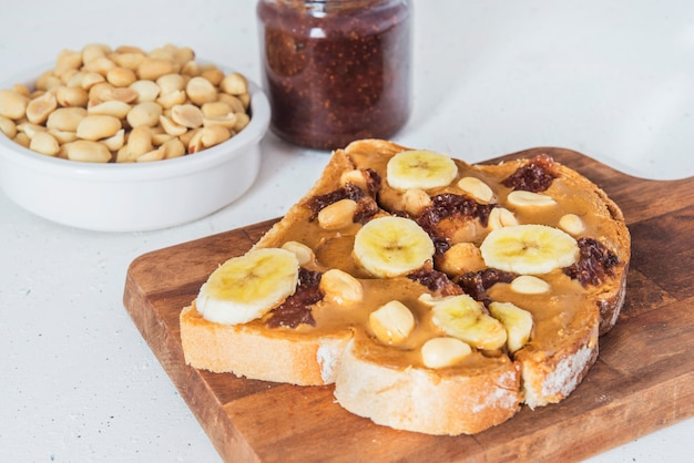 Bread with peanut butter and raspberry marmalade