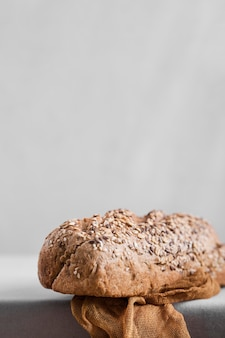 Bread with seeds and white background