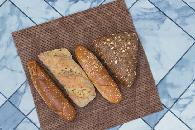 Bread with sunflower seeds and sesame seeds on a wicker napkin