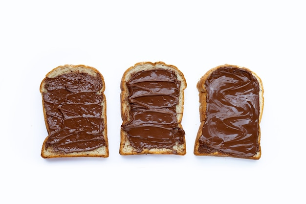 Bread with sweet chocolate hazelnut on white background.