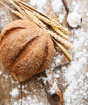 Bread with wheat ears and flour
