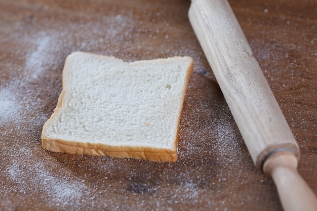 Bread on wooden background.