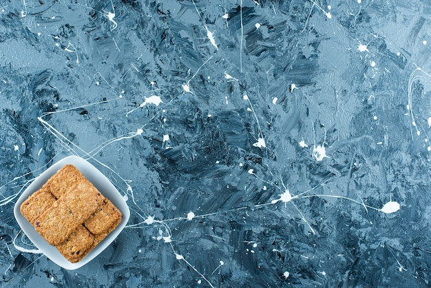 Breadcrumbs on a plate , on the marble background.