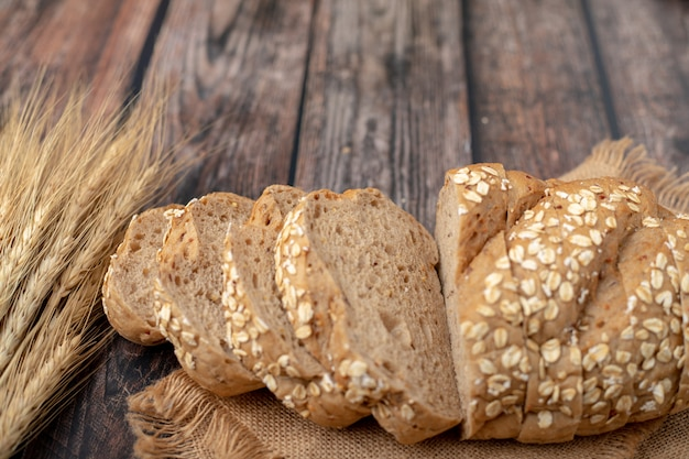 Breads sliced and wheat on the sack