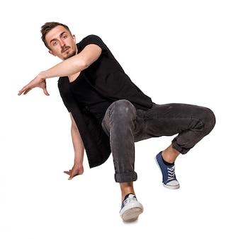 Break dancer doing one handed handstand against a white background