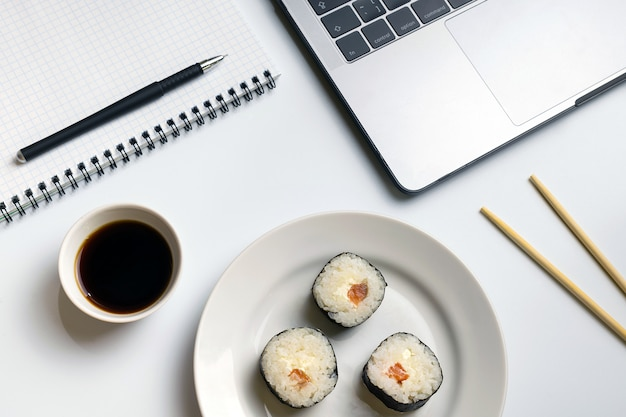 Break time for sushi eating. sushi rolls snacking at work.