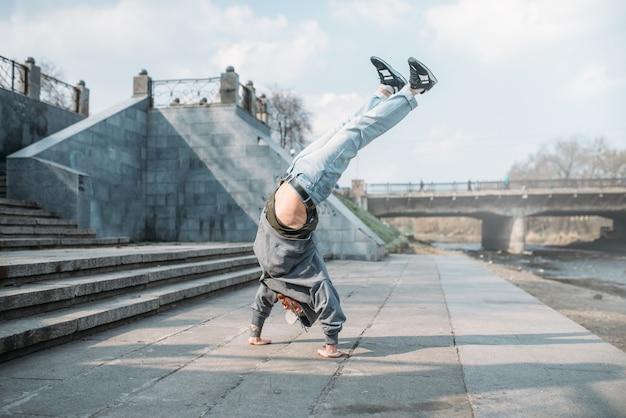 Breakdance performer, upside down motion on street