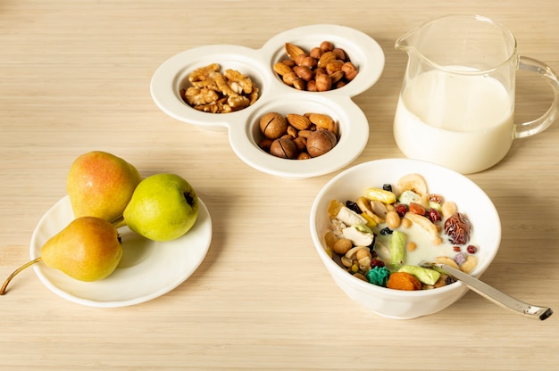 Breakfast arrangement on plain background