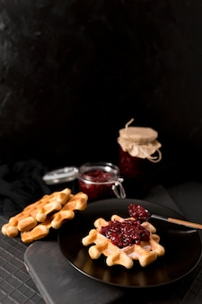 Breakfast arrangement waffles and raspberry jam high view
