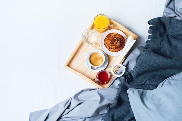 Breakfast bed tray coffee bun grey early morning