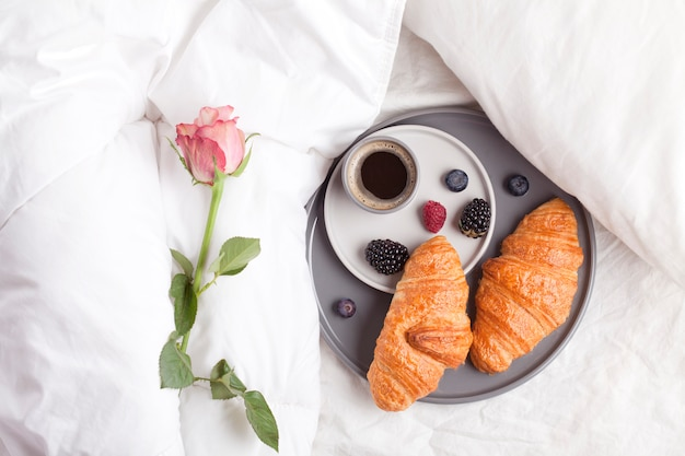 Breakfast in bed with coffee, croissant