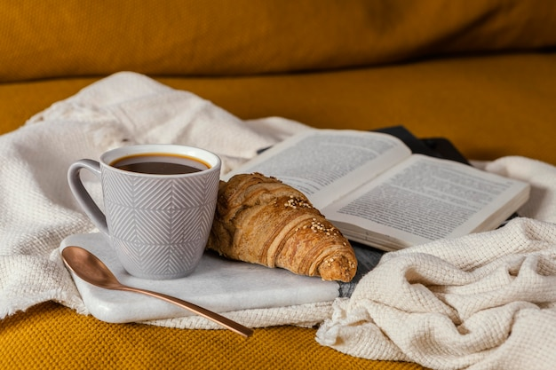 Breakfast in bed with croissant and coffee