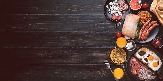 Breakfast on a black wooden table in rustic style