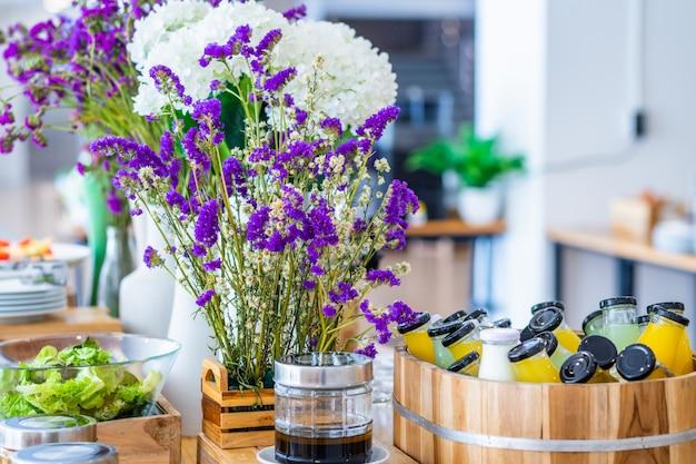 Breakfast buffet line organic raw put in juice drink bottle