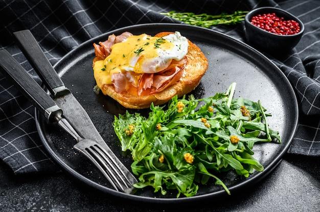 Breakfast burger with bacon, egg benedict, hollandaise sauce on brioche bun