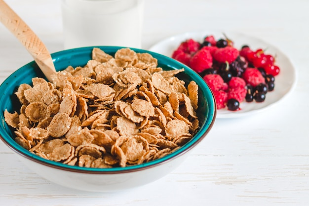 Breakfast cereal with milk on a white background