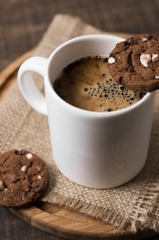 Breakfast coffee in white mug and cookies high view