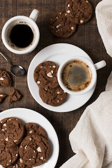 Breakfast coffee in white mug and cookies top view