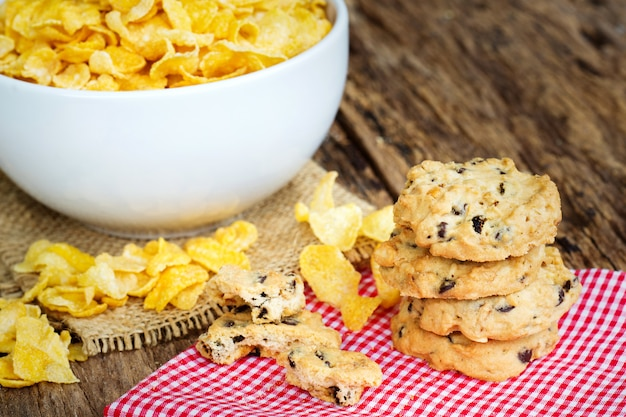 Breakfast concept, cookies and cornflake cereals on table.